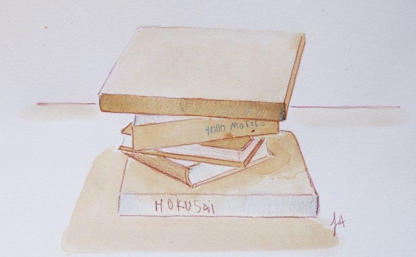 Comment appliquer les principes de la perspective en dessinant une pile de livres au thé noir ?